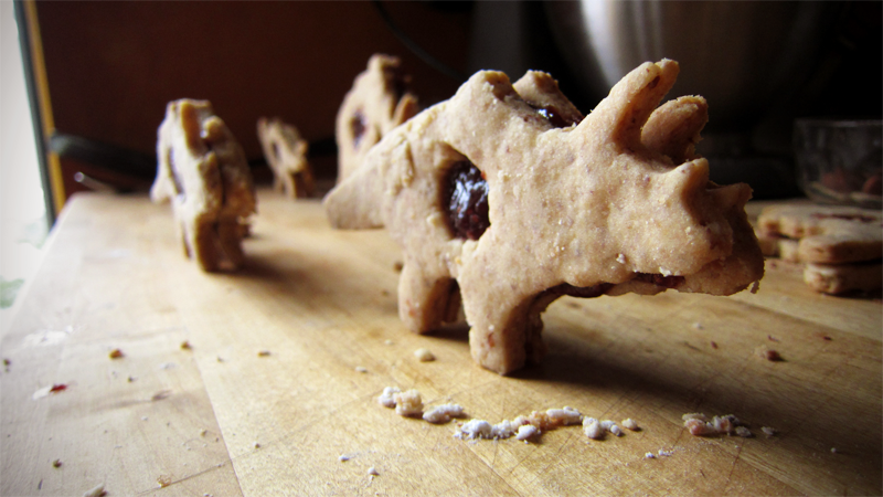 almond and jam dinosaur sandwich cookies.